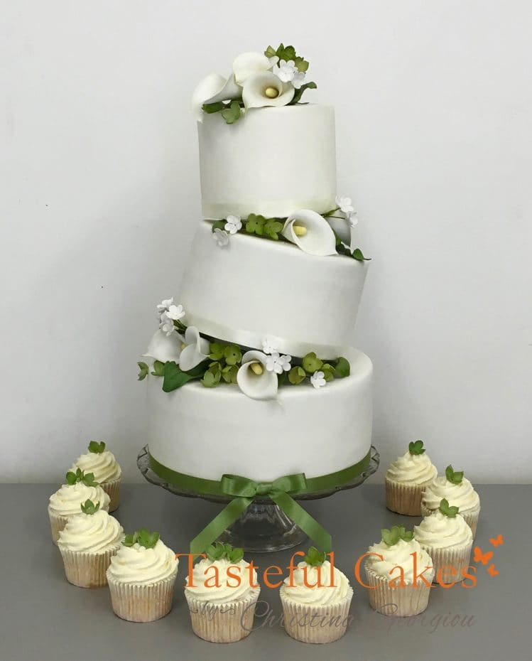 Tilted Green and White Wedding cake with Cupcakes