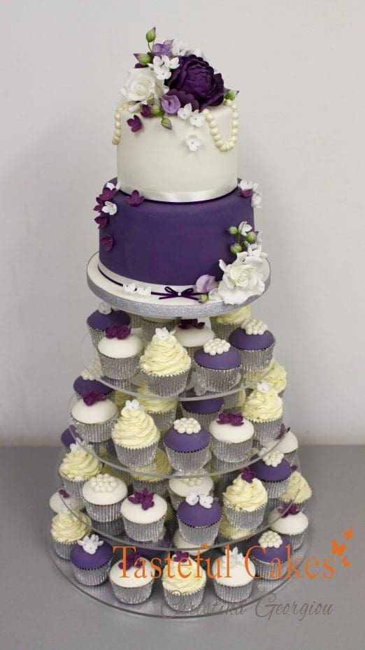 2 tier floral stacked purple, white and cream wedding cupcake tower.