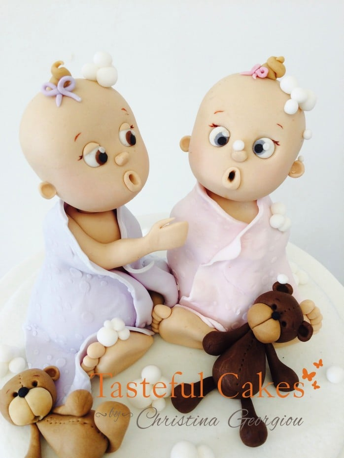 Twin Baby cake toppers and christening cake, with baby block names and teddy bears. cakes in Waltham Abbey Essex