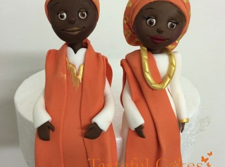 African wedding cake bride and groom topper, in there traditional african clothing
