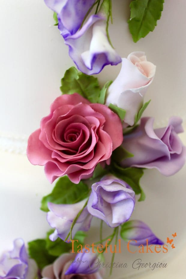 Cascading Pink and lilac Roses, five tier wedding cake, sugar wired cascading flowers, sugar wired flower courses