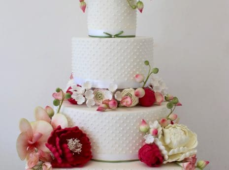 Floral wedding cake, four tier wedding cake, hand piped dots, Sugar wired flowers, sugar ranunculus hydrangers peony lisianthus.