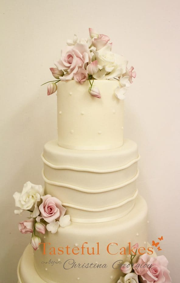 Four tier wedding cake, ivory wedding cake, Sugar wired flowers, sugar roses and lisianthus