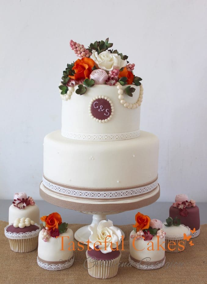 2 tier stacked autumnal floral stacked wedding cake with mixed cupcake and mini cake wedding cupcake cake tower.